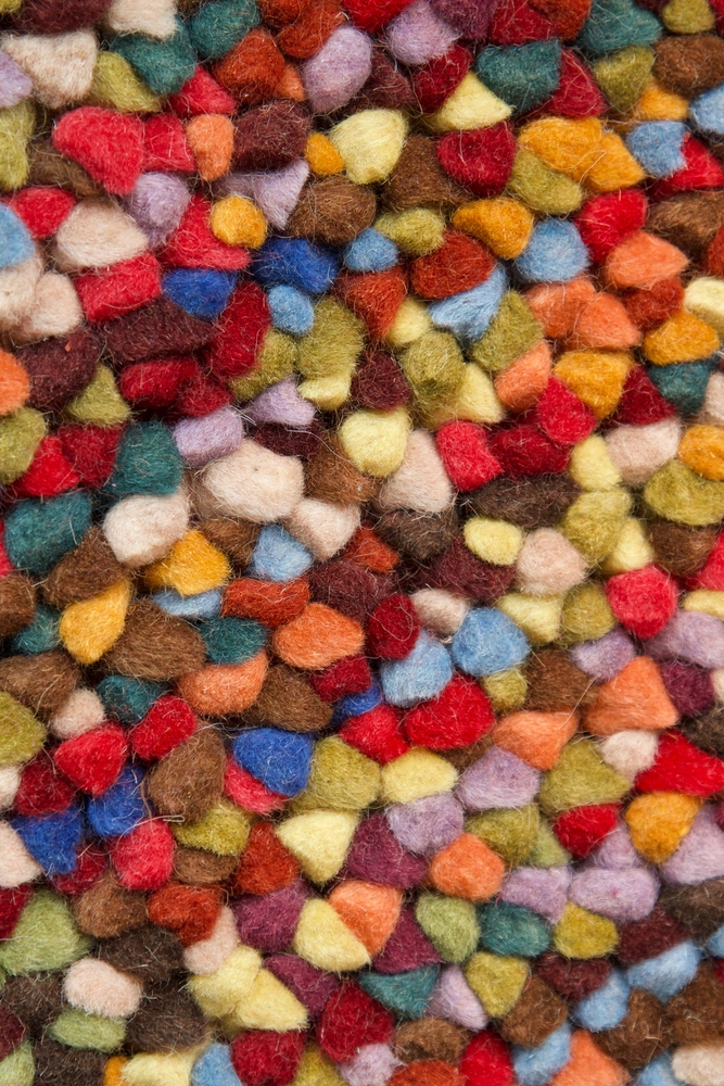 Disfigured felt wool ball rug